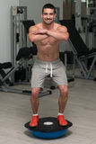 Young Man Exercising - Bosu Balance Ball Royalty Free Stock Photos