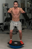 Young Man Exercising - Bosu Balance Ball stock photos