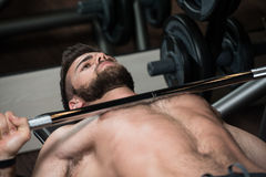 Young Man Exercising Chest With Barbell Stock Images