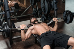 Young Man Exercising Chest With Barbell Stock Photo