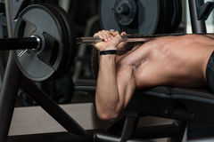Young Man Exercising Chest With Barbell Stock Photography