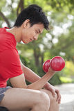 Young Man exercising with Dumbbell Royalty Free Stock Photos