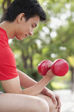 Young Man exercising with Dumbbell Royalty Free Stock Photo