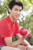 Young Man exercising with Dumbbell Royalty Free Stock Image