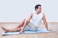 Young Man Exercising On Exercise Mat Stock Images