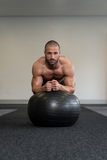 Young Man Exercising With Fitness Ball Abs Exercise Stock Photography