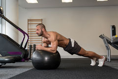 Young Man Exercising With Fitness Ball Abs Exercise Royalty Free Stock Photography