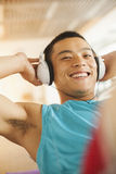 Young man  exercising in the gym Stock Photo