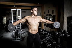 Young man exercising  gym Royalty Free Stock Photography