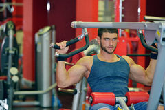 Young man exercising in the gym Royalty Free Stock Image
