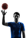 Young man exercising handball player silhouette. One caucasian young man exercising handball player in silhouette studio  on white background Royalty Free Stock Image