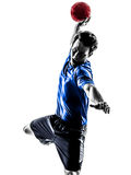 Young man exercising handball player silhouette. One caucasian young man exercising handball player in silhouette studio  on white background Stock Photos