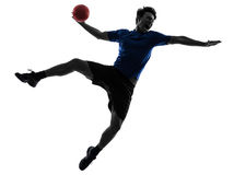 Young man exercising handball player silhouette. One caucasian young man exercising handball player in silhouette studio  on white background Stock Images