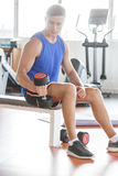 Young man exercising his arm using dumbbell Stock Photo