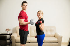 Young man exercising with his girlfriend Stock Photo