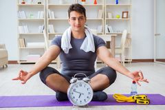 Young man exercising at home in sports and healthy lifestyle con Royalty Free Stock Photo