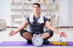 Young man exercising at home in sports and healthy lifestyle con. Cept Royalty Free Stock Photo