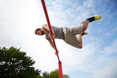 Young man exercising on horizontal bar outdoors Royalty Free Stock Image