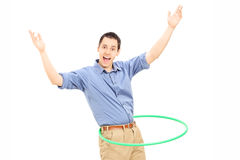 Young man exercising with hula hoop Royalty Free Stock Image
