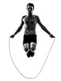 Young man exercising jumping rope silhouette Stock Photo