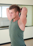 Young man exercising with kettlebell in gym Stock Photography