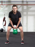 Young man exercising with kettlebell Royalty Free Stock Photo