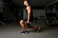 Young Man Exercising Lunges with Weights Royalty Free Stock Image