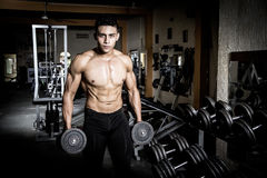 Young man exercising old gym Stock Image