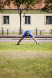 Young man exercising outdoor. Young man exercising in outdoor Royalty Free Stock Image