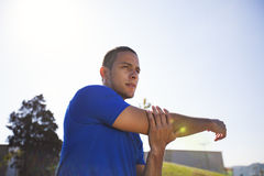 Young man exercising outdoor. Young man exercising in outdoor Royalty Free Stock Photography