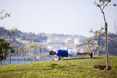 Young man exercising outdoor Royalty Free Stock Images