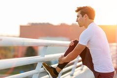 Young man exercising outdoors royalty free stock photos