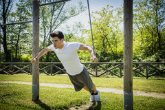 Young man exercising outside in city park Royalty Free Stock Image