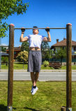 Young man exercising outside in city park Royalty Free Stock Photography