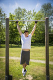 Young man exercising outside in city park Stock Images