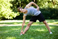 Young man exercising in a park Stock Photo