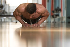 Young Man Exercising Push Ups Royalty Free Stock Images