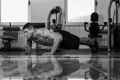 Young Man Exercising Push Ups Royalty Free Stock Photography