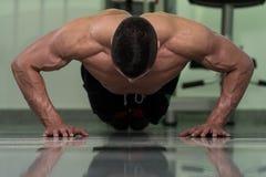 Young Man Exercising Push Ups Stock Photography