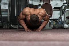 Young Man Exercising Push Ups Royalty Free Stock Images