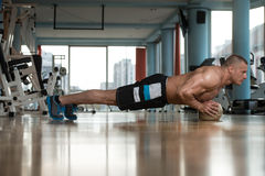 Young Man Exercising Push Ups On Fitness Ball. Young Adult Athlete Doing Push Ups On Medicine Ball As Part Of Bodybuilding Training Stock Image