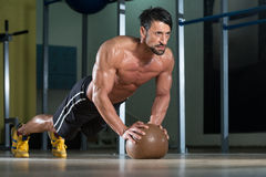 Young Man Exercising Push Ups On Medicine Ball Stock Photo