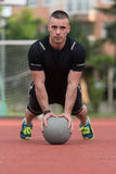 Young Man Exercising Push-Ups On Medicine Ball Outdoor Royalty Free Stock Photography