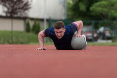 Young Man Exercising Push-Ups On Medicine Ball Outdoor Royalty Free Stock Photos
