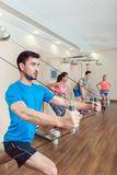 Young man exercising with the resistance bands of an anchor gym system royalty free stock photo