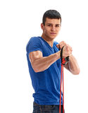 Young man exercising with rubber expander Stock Photography