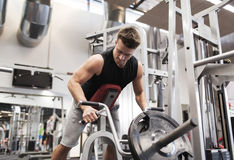 Young man exercising on t-bar row machine in gym Royalty Free Stock Photos