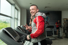 Young Man Exercising On A Treadmill Royalty Free Stock Photography