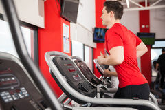 Young man exercising on a treadmill Stock Photography