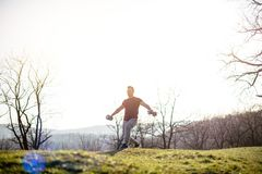 Young man exercising with weights Royalty Free Stock Photography